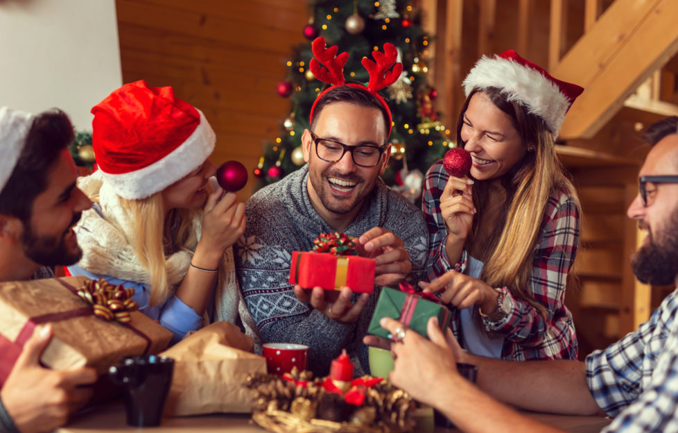 Family Christmas, man opening gift Pic: Shutterstock