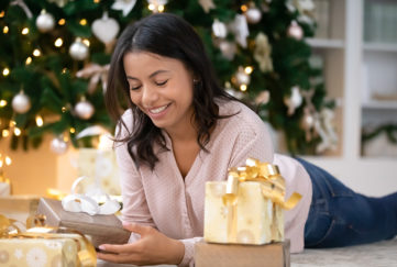 Lady opening Christmas gifts Pic: Shutterstock