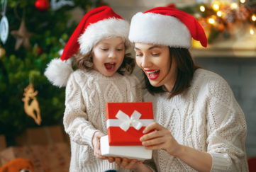 Mum and daughter opening gifts on Christmas day Pic: Shutterstock