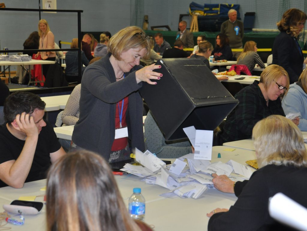 One of the ballot boxes  is emptied before the counting begins.