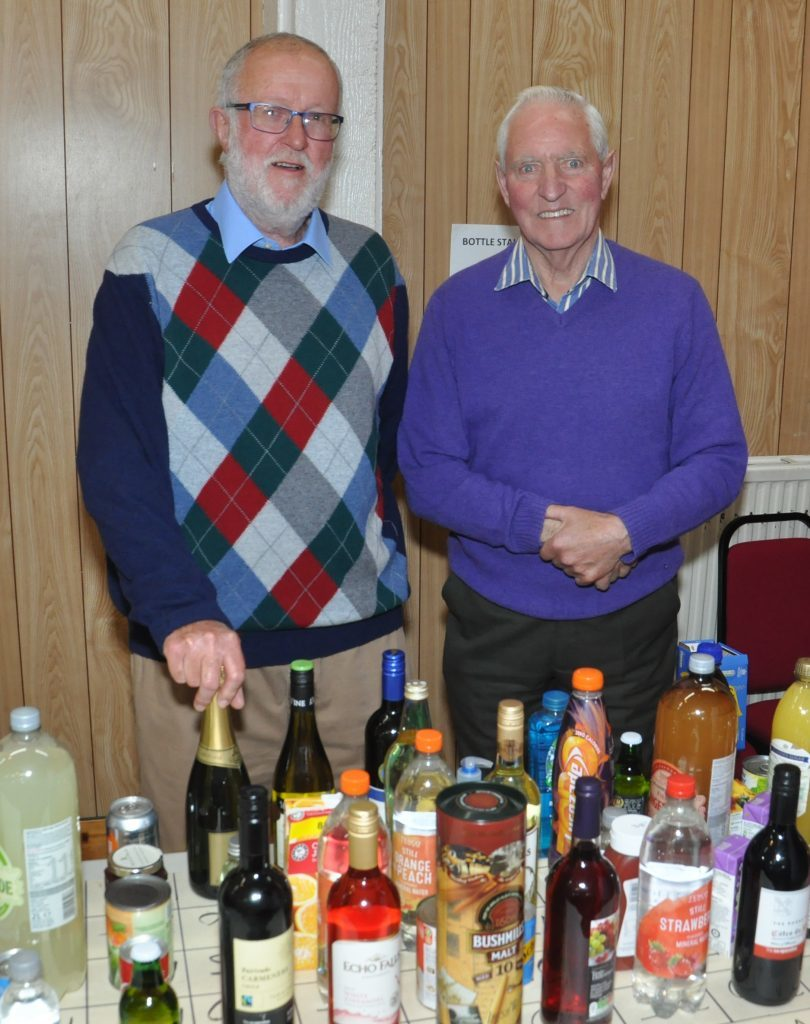 Tony Leighton and William Semple took control of the bottle stall. 20_c28carradale03_bottle stall