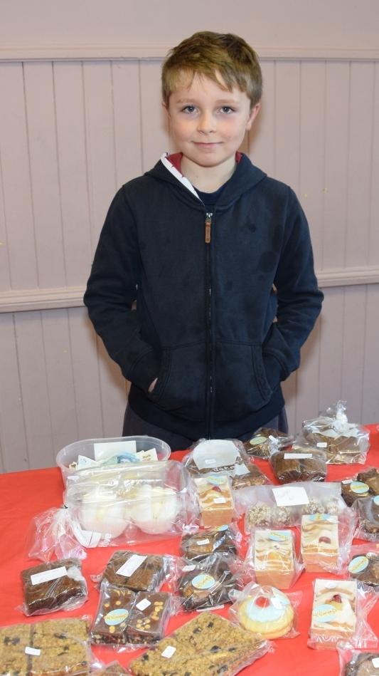 Alistair McArthur, 10, helped sell baking. 50_c37glenbarr02_baking p18