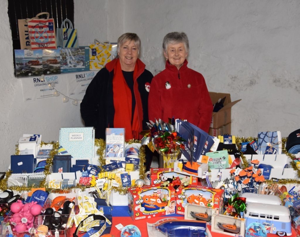 Volunteers Sue Morgan and Hilary Lord sold a treasure trove of nautical-themed gifts at the RNLI stand. 50_c48market08_rnli