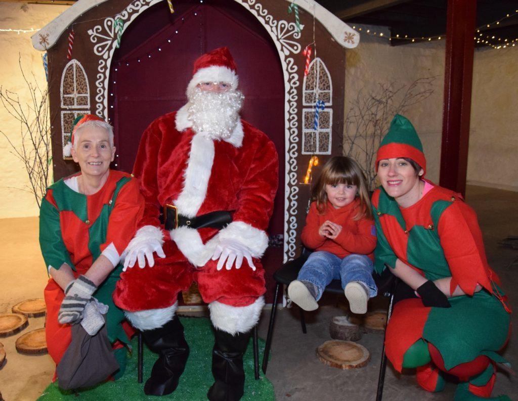Three-year-old Lucy Carey told Santa and his elves what she hopes to get for Christmas. 50_c48market17_santa's grotto