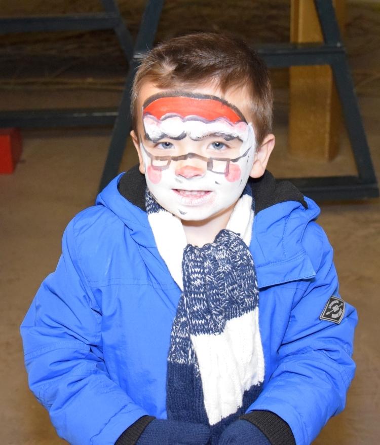 Face paints transformed Shaun Borthwick, four, into Santa. 50_c48market18_face painted