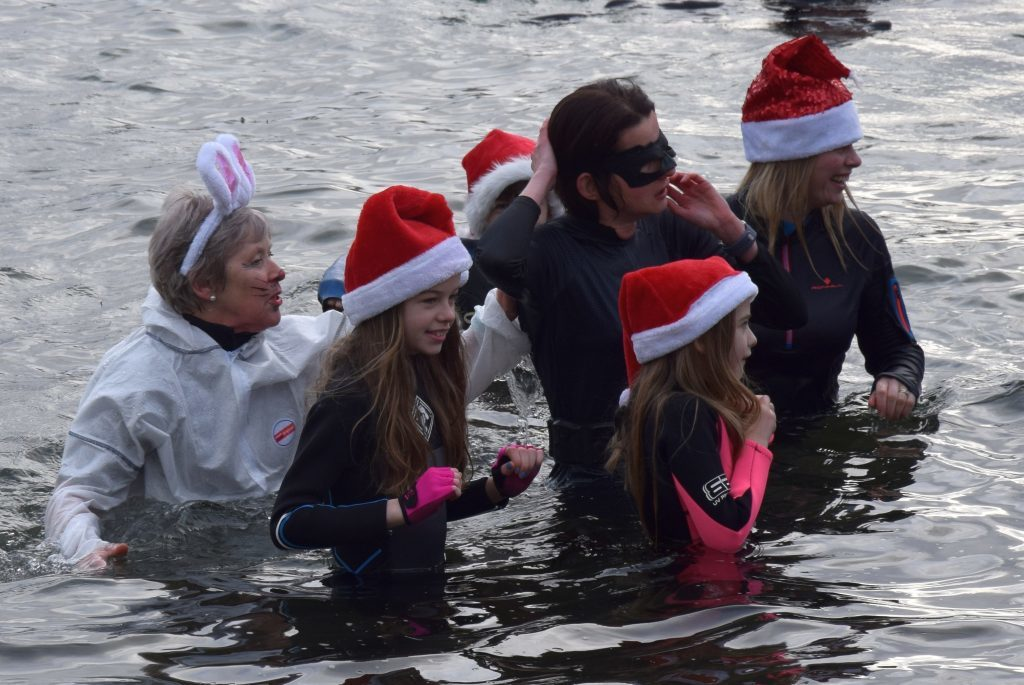 These brave dippers have their Santa hats on to keep them warm! 50_c01dipfordosh05