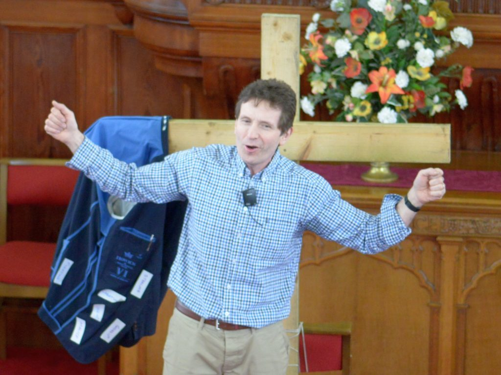 Paster Chris Holden giving his sermon.