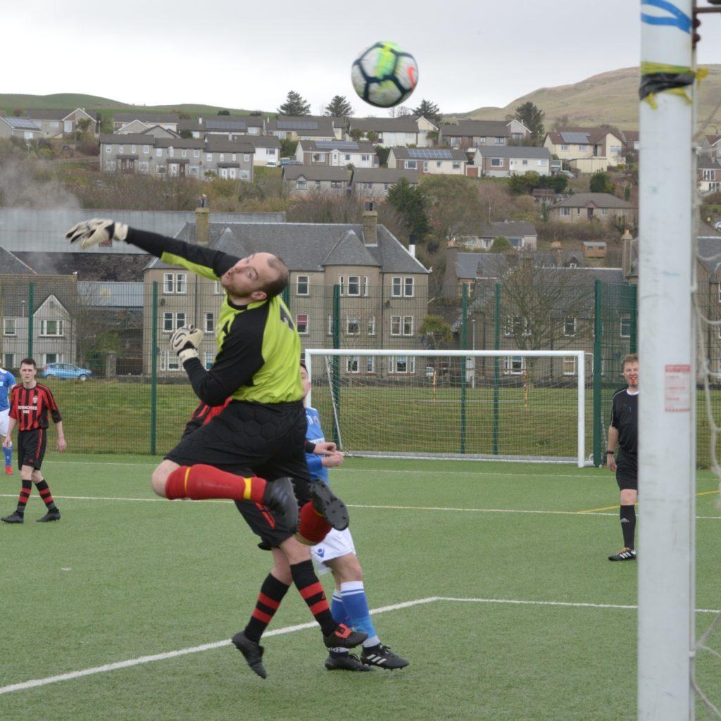 Port Glasgow's goalie makes a valiant save.