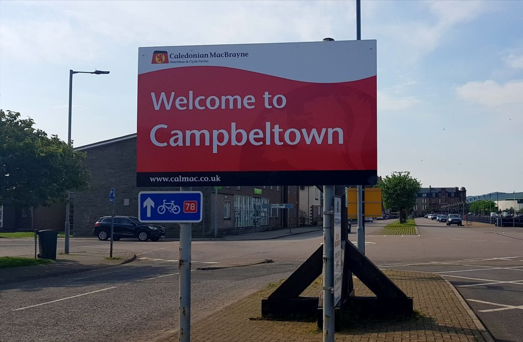 A CalMac sign welcomed passengers into the town.