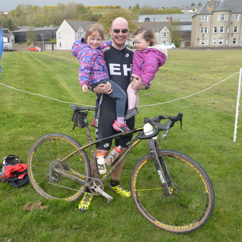 ​Kintyre Way Ultra Cycle race winner Calum Simpson celebrates with his daughters: Robyn, ​four,​ and Erika one-and-a-half.  25_c19kwultra03_bike_race_main_winner