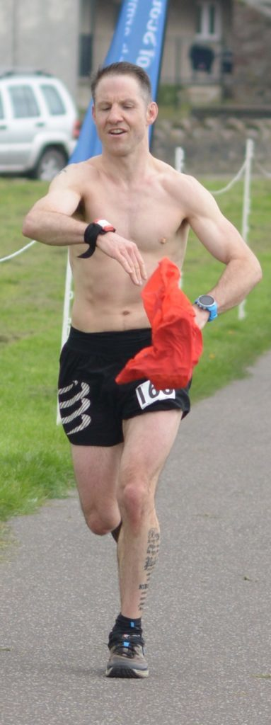 ​Ultra marathon winner Graham Connolly ripped off his shirt as he approached the line. 25_c19kwultra06_winner