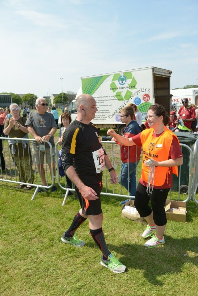 Peter Waugh collects his medal.