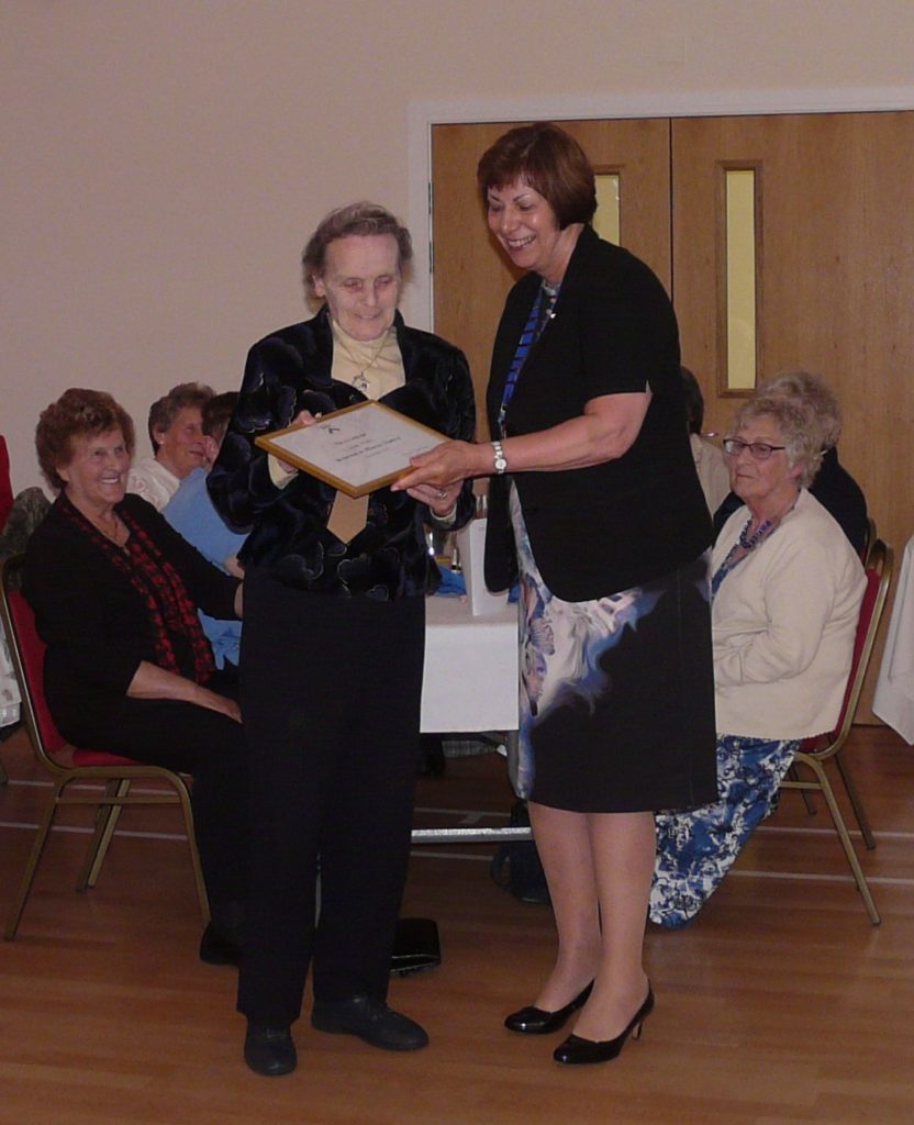 Louise Wilson being presented with an honorary membership certificate from Linda Retson, national chairman of SWI.