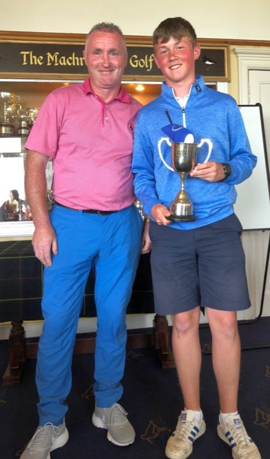 Club captain, Calum MacMillan, with Fraser MacBrayne, who won the 18-hole championship.