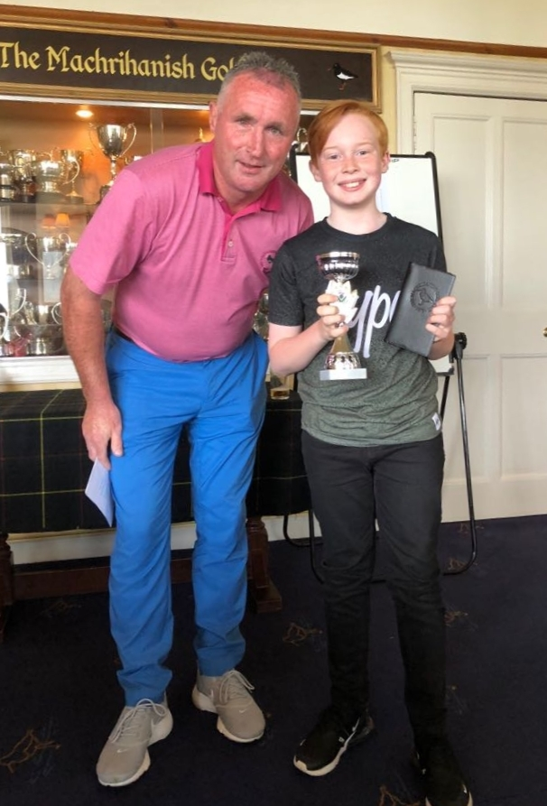 Drew McLellan, pictured with captain Calum MacMillan, triumphed in the nine-hole tournament.