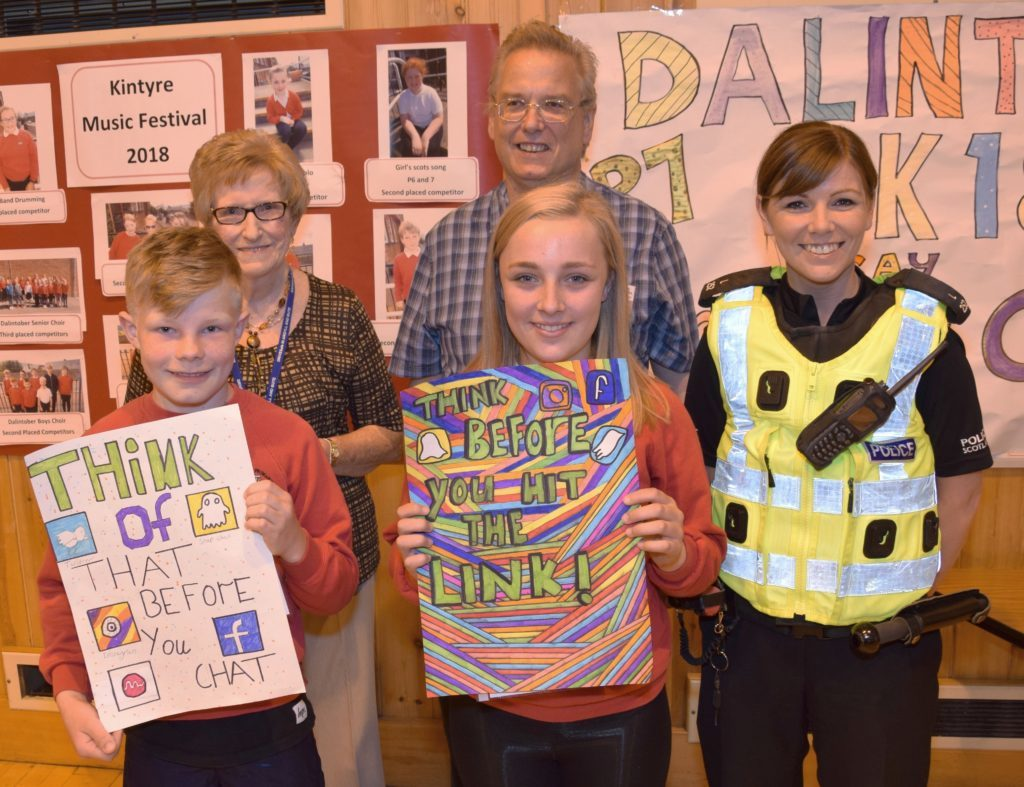 Dalintober prize-winners Craig Bell and Dion Maguire, front, with Eva MacDonald and Andrew Hemmings and PC Karen Cairns, back.