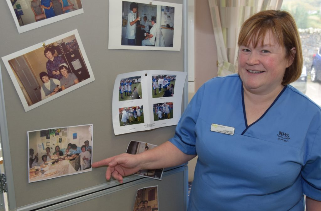 Louise Kerr, unscheduled care practitioner, points to herself in a photograph which also includes her daugher, Lucy, now aged 18
