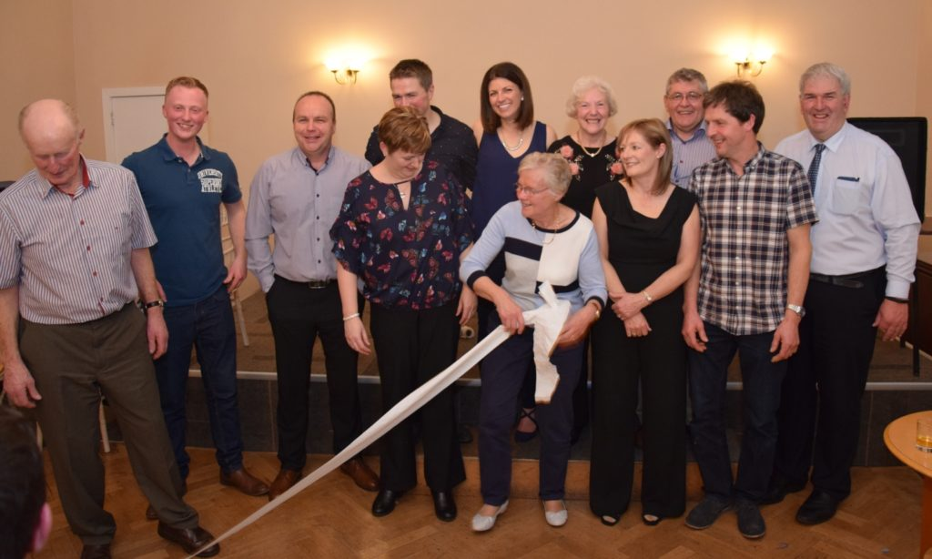 Toilet humour: As the couples lined up for a photo, joined by MC John Armour, right, and Campbeltown Young Farmers spokesperson Jamie McLean, second left, a loo roll was thrown.