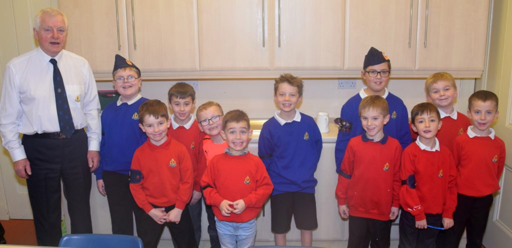 Alister Nimmo, captain of the 1st Campbeltown company, with some of the boys who helped at the coffee morning.