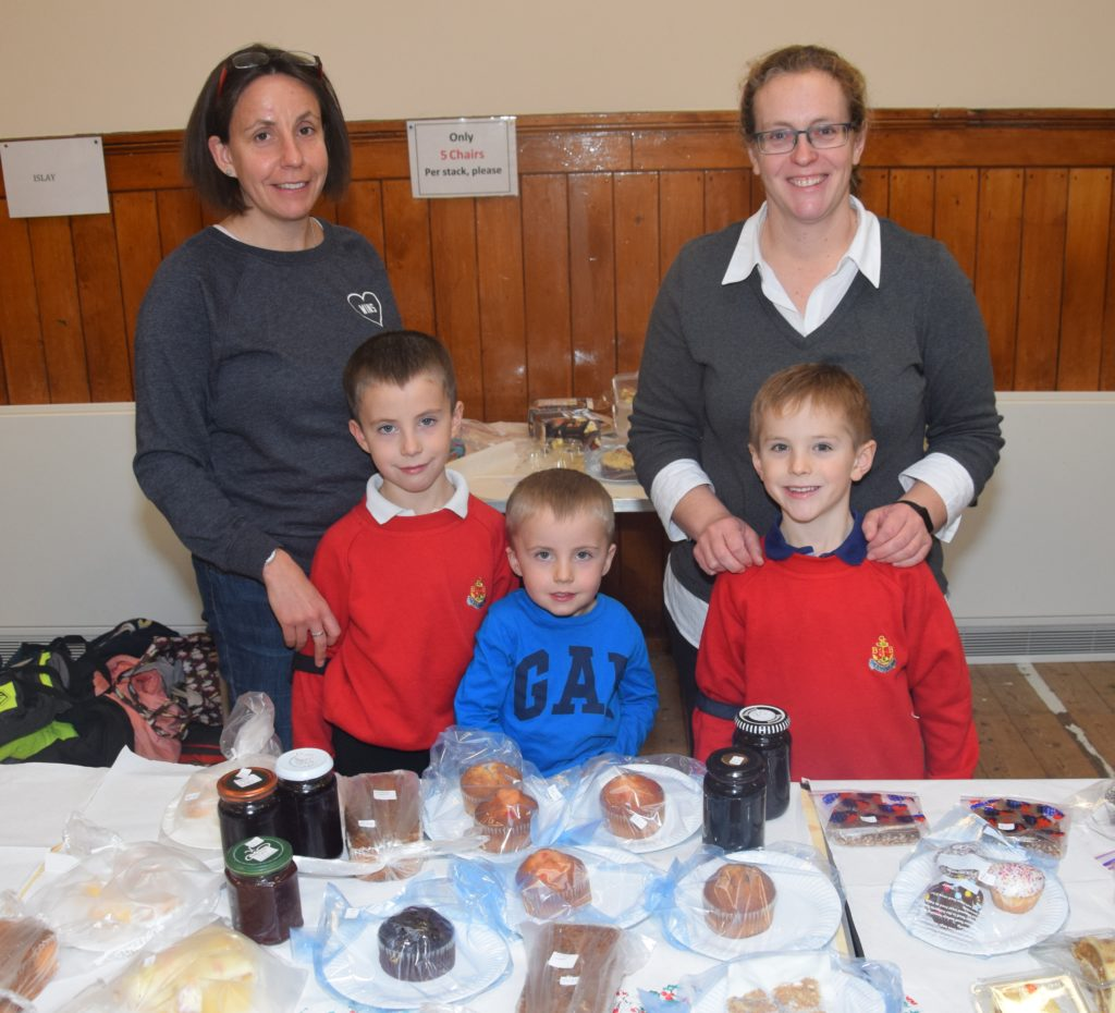 Finlay Ramsay, Robbie Ramsay and Murray Mackay helped their mums Lindsay Ramsay and Valerie Mackay behind the baking stall.