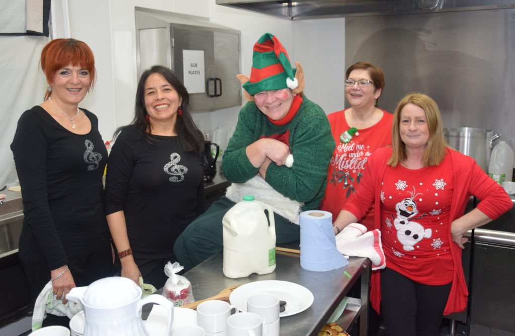 In the kitchen, from left: Valentina Cataldi, Katuska Davies, 'elf on the shelf' Liz Kennedy, Margaret Kelly and Lorraine Gillespie.