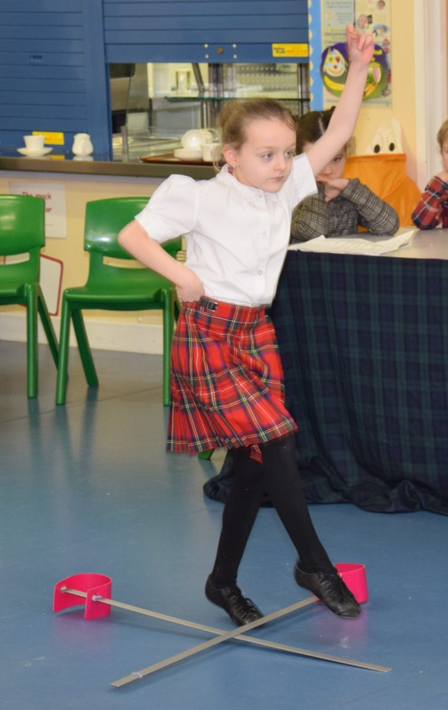 P3 Taylor performs the sword dance.
