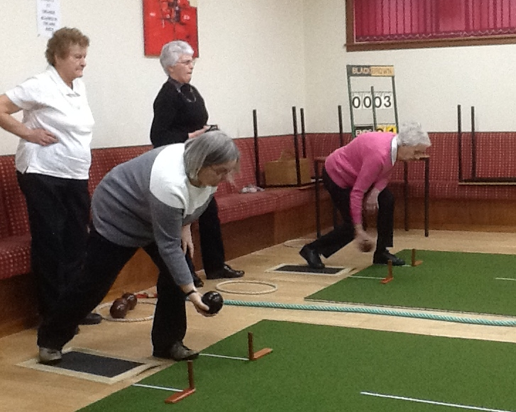 Christine Jardine and Elsie Ronald in action as Jane McCorkindale and Margaret Bakes wait their turn to bowl.