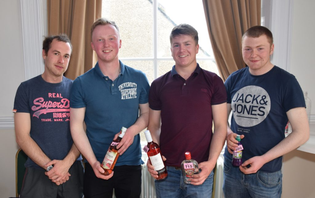 Michael Smith, Jamie McLean, Campbell O'May and Robert McDonald manned the bottle stall.