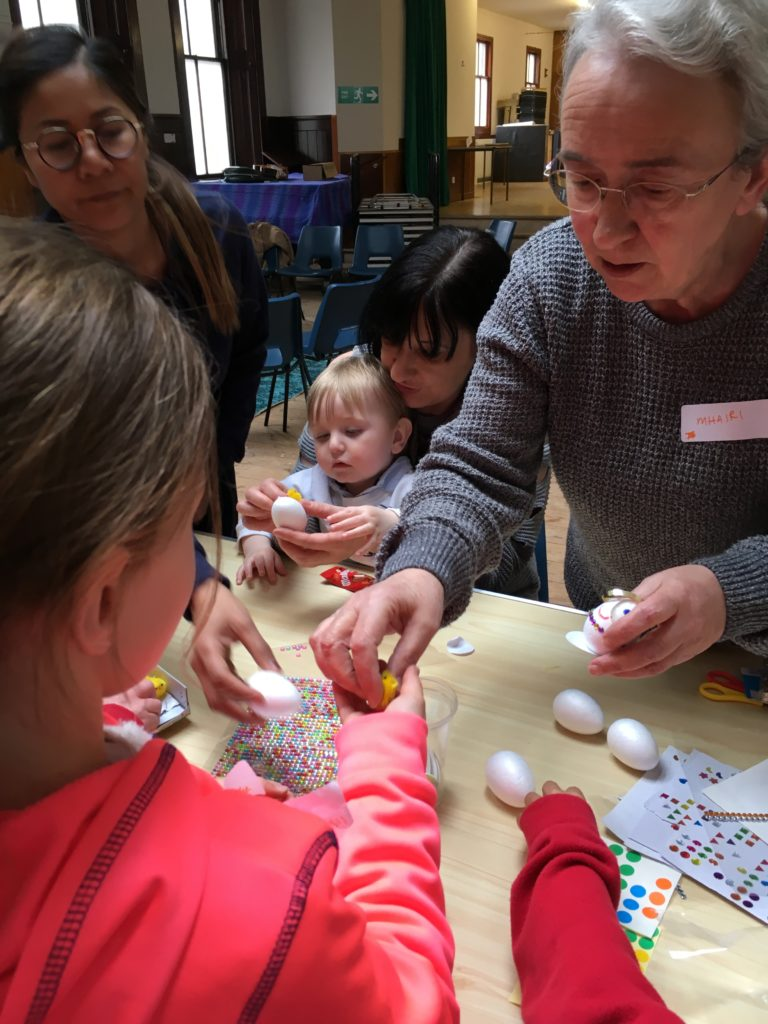 Mhairi Reid helps with egg decorating.