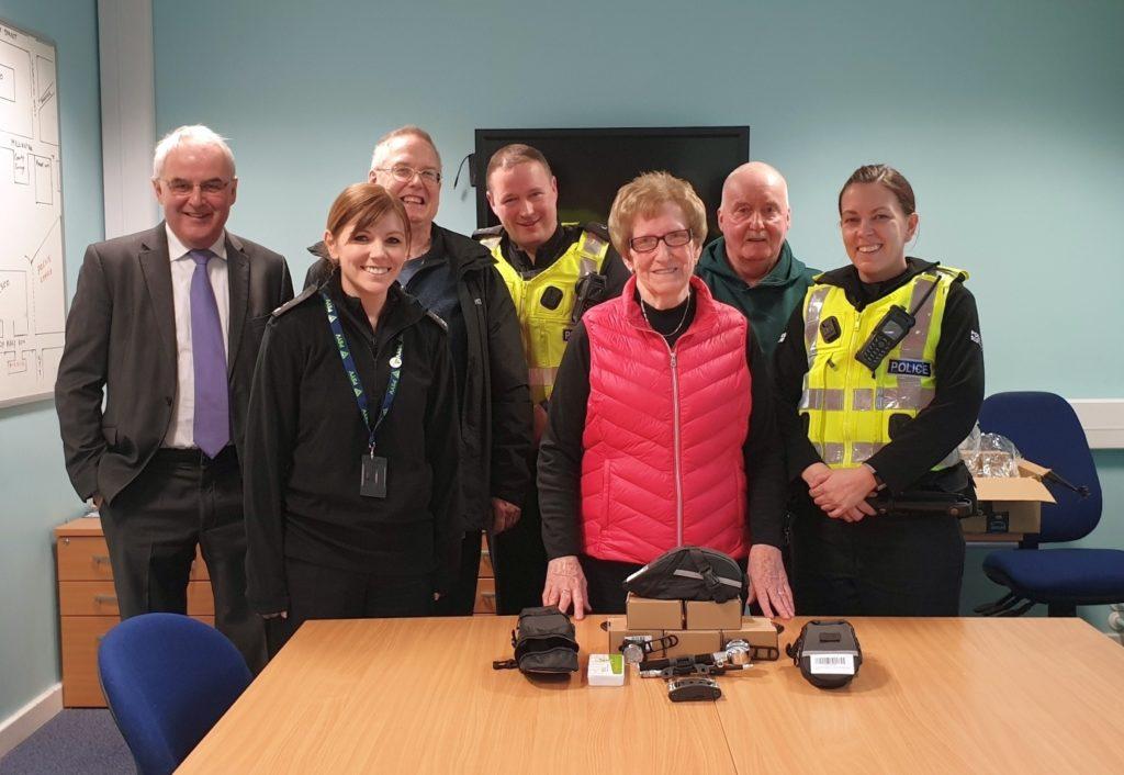 With bicycle lights and repair kits, from left: Rodger Crooks, PC Karen Cairns, Andrew Hemmings, PC John McGeachy, Eva MacDonald MBE, Robert Strand, PC Gillian Watson.