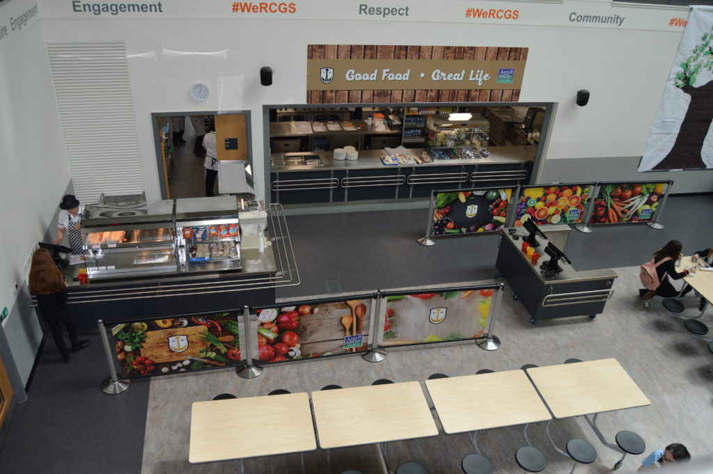 Looking down from the first floor of the atrium to the school cafeteria there is a second, smaller one, serving pasta.