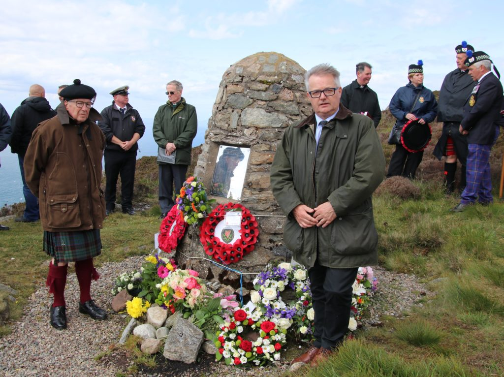 Lord Lieutenant Patrick Stewart, left, and Brendan O'Hara MP stand either side of the memorial cairn.