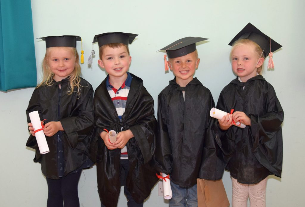 Four of the five pre-five children who have graduated from nursery.