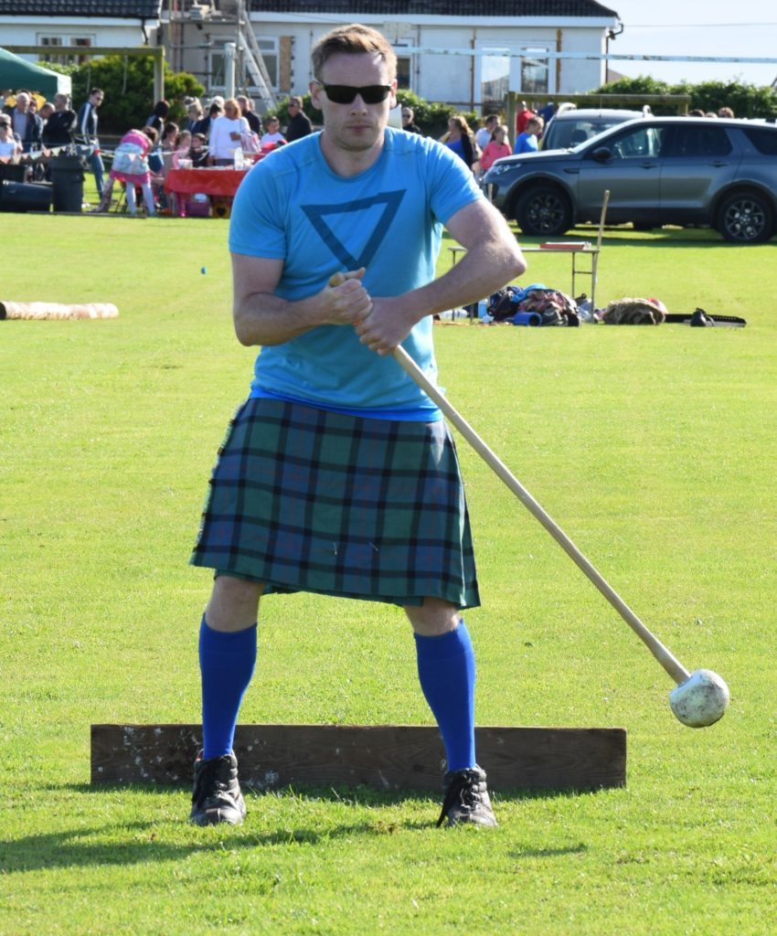 Paul Dearie, 38, from Carluke, South Lanarkshire, throwing the hammer.