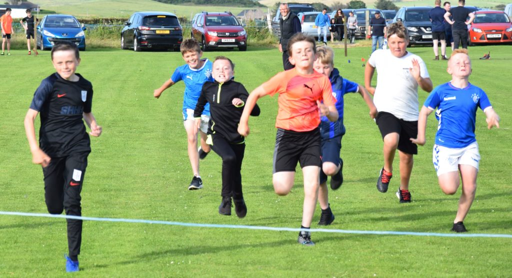 A close finish for the boys in the 10 to 12-year-olds' race.