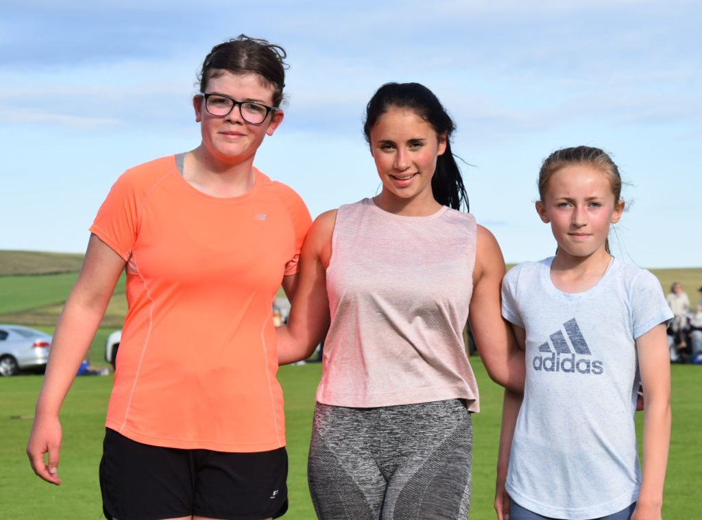 Winner of the ladies' half-mile race, 15-year-old Jilly Lefebvre, centre, with second-placed Caryn Kerr, also 15, left, and third-placed Kirstie Renton, 11, right. Kirstie had already won second place in the girls' 800m race.