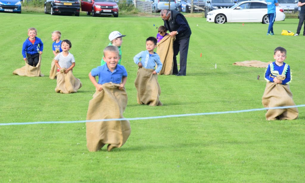 Great fun in the boys' sack race.