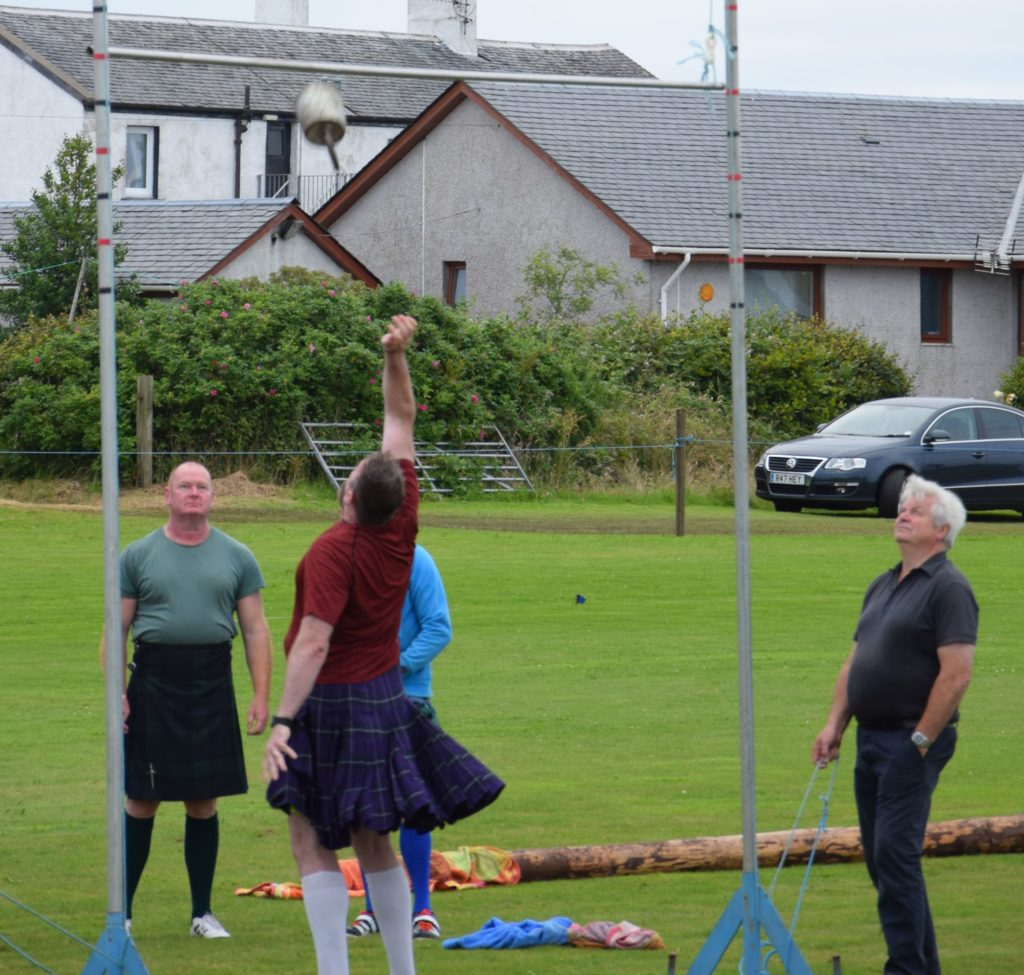 Alan Butler from Port Glasgow watches his opposition throw the 228lb weight.