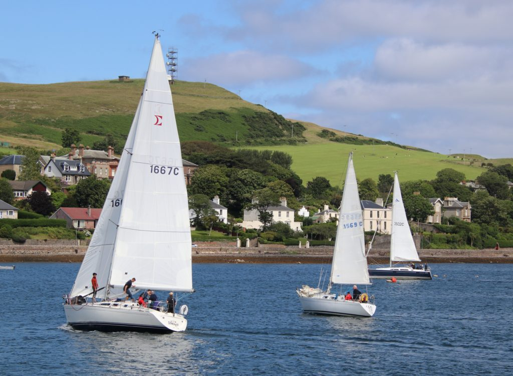 The winning yacht, Sigmania, left, with Alastair Cousin's Carna, middle, and Oisin, from Cushendall, right.