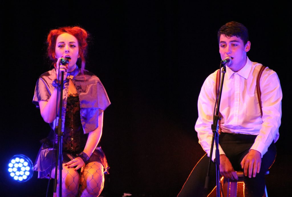 Hope Strang and Ruairidh Wallace performed together during a rendition of Re-write the Stars.