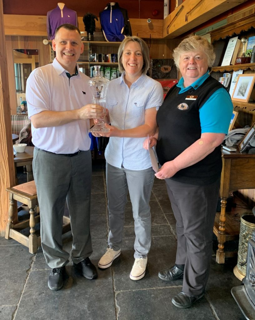 Machrihanish Dunes' general manager, Andy Hogan, and golf house manager, Lorna Barr, present the ladies' Campbeltown Open trophy to Anne Laing, centre. Photo: John McFadyen.