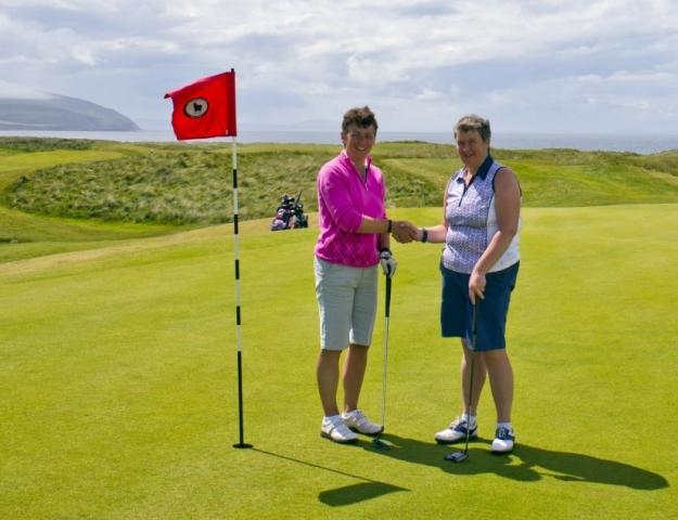 Ailie MacBrayne, left, congratulates her playing partner Ann Gallacher on winning the Colin Chrystie Quaich. Photo: John McFadyen.