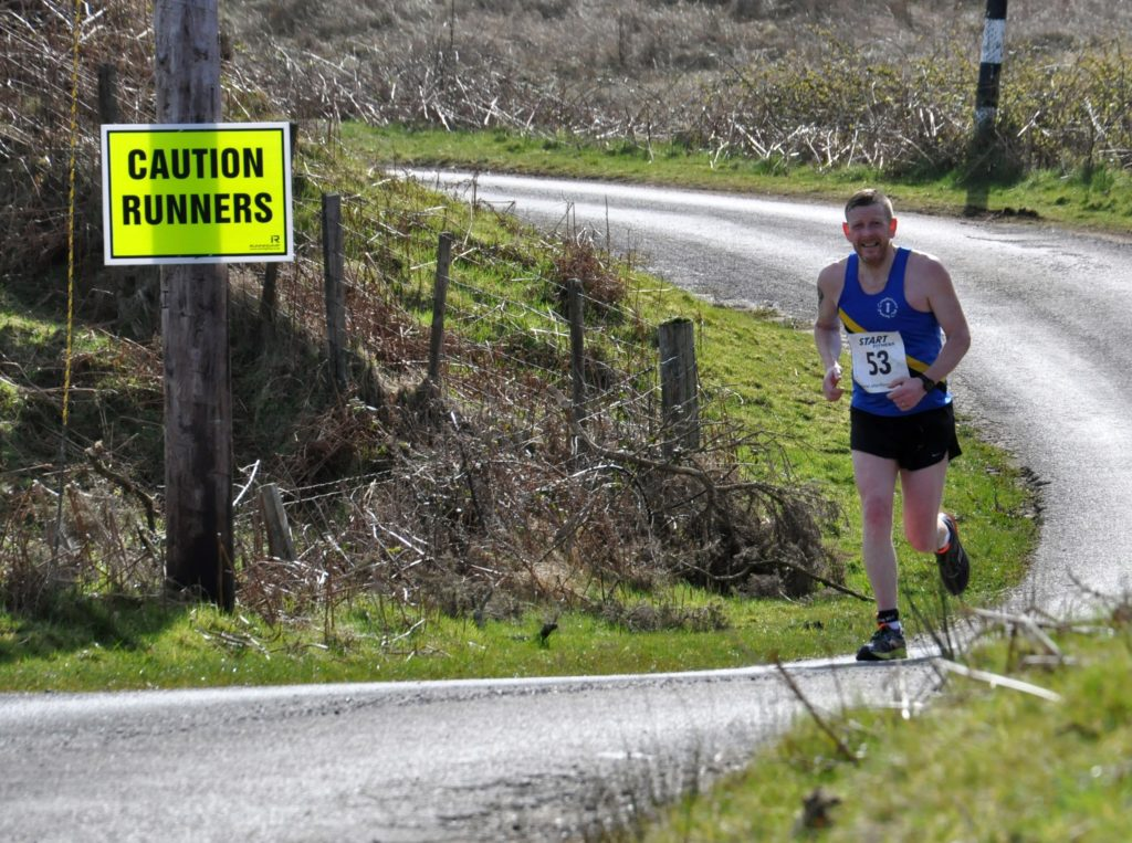 Even the hilly sections towards the end of the race didn't stop runners like Ewan Smith smiling for the camera.