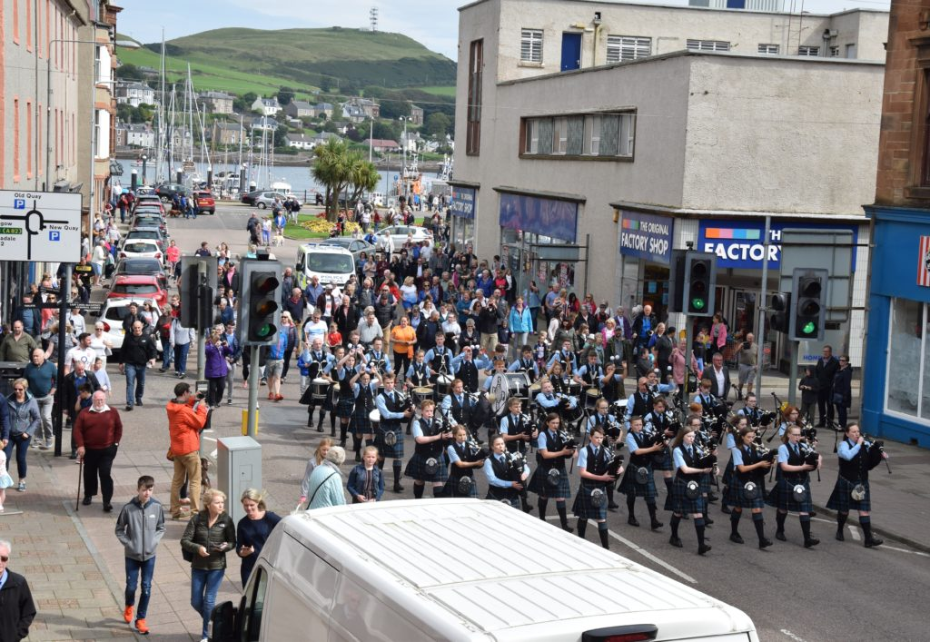 The massed Kintyre Schools and Beinn an Tuirc pipe bands kicked off Saturday's open air events by marching from the head of the Old Quay to Springbank Distillery.