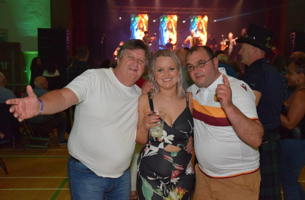 Archie McMillan, Jennifer McMillan and Ewan McIlroy with Manran on stage.