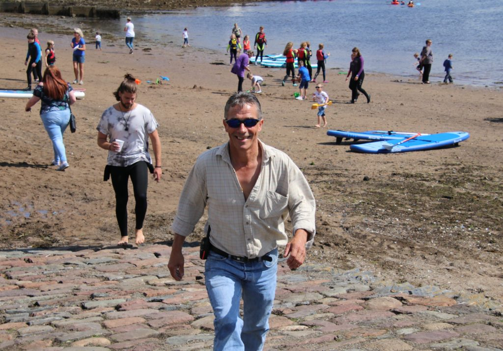Jamie McLean of Dalintober Beach Group was all smiles as he made his way across the packed shore.