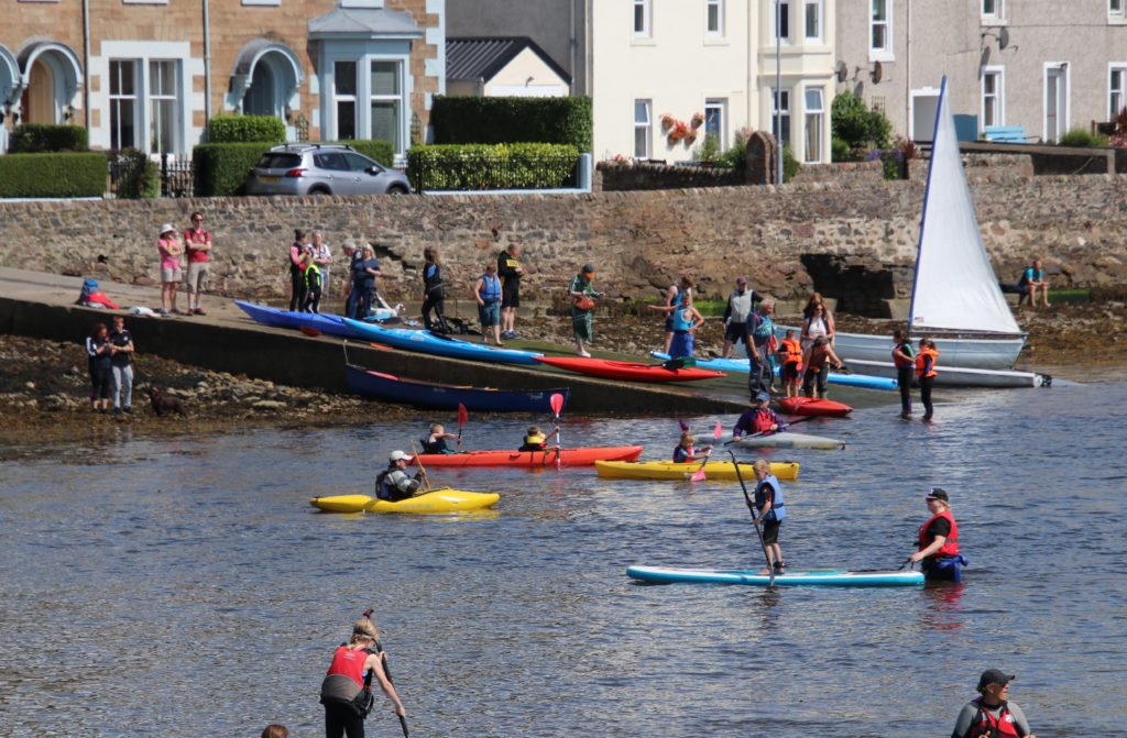 Canoes and kayaks were on the loch, as well as paddle boards.