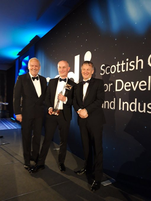From left, Giles Brandreth who presented the award with Martin Jones, principal of Argyll College UHI, and Ivan McKee MSP.