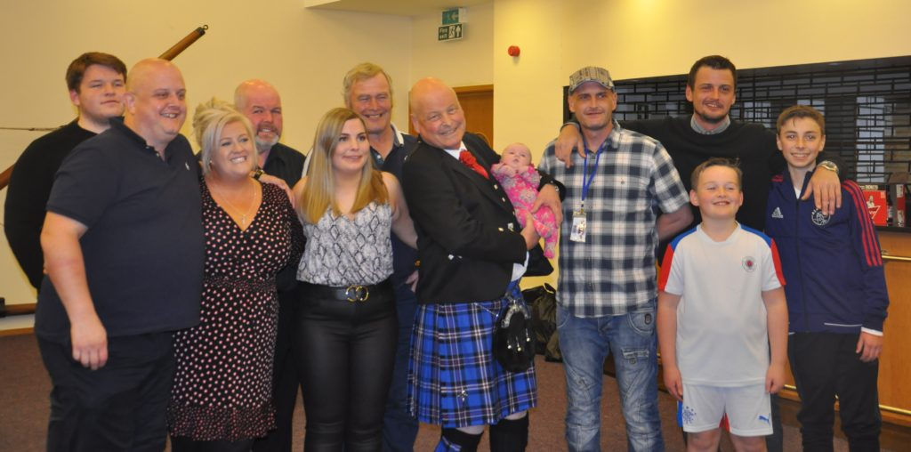 Callum Semple, centre, was joined by all his family at the event. From left: nephew Richard, son Callum, daughter-in-law Gillian, brother Richard, daughter Rebecca, brother John, Callum holding granddaughter Lexi Jane, son Allan, son Iain standing behind grandson Callum, and son Andrew.