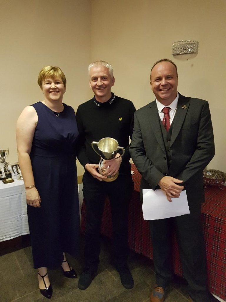George MacMillan, gents' club champion, centre, with Club captain Willie Ross and his wife Kirsteen.